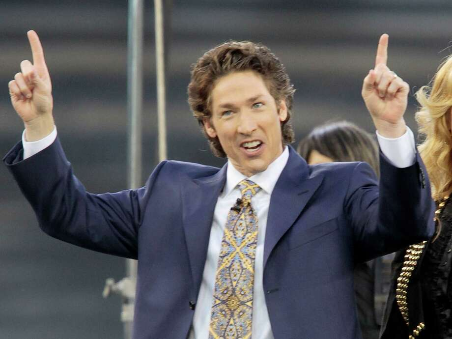 """FILE - This April 24, 2010 file photo shows Lakewood Church pastor Joel Osteen at Dodger Stadium during his """"A Night of Hope"""" in Los Angeles. Osteen is getting his own channel on SiriusXM satellite radio, which will air his sermon at Yankee Stadium this Saturday, June 7, 2014.See how Osteen's Lakewood Church has grown in the past 50 years into one of the world's largest ministries ... Photo: Richard Vogel, AP / AP"""