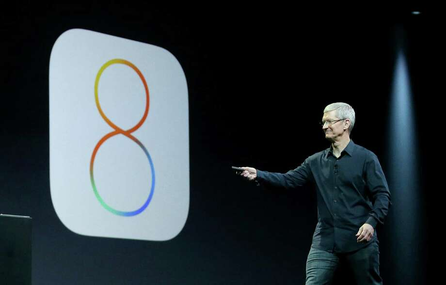 Apple CEO Tim Cook speaks about iOS 8 at the Apple Worldwide Developers Conference in San Francisco, Monday, June 2, 2014. Photo: Jeff Chiu, AP / AP
