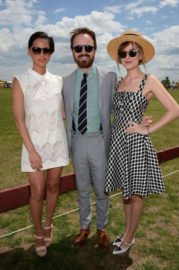 Olivia Munn, Aaron Paul and Dakota Johnson attend the seventh annual Veuve Clicquot Polo Classic in Liberty State Park on May 31, 2014 in Jersey City City. Photo: Dimitrios Kambouris, Getty Images For Veuve Clicquot