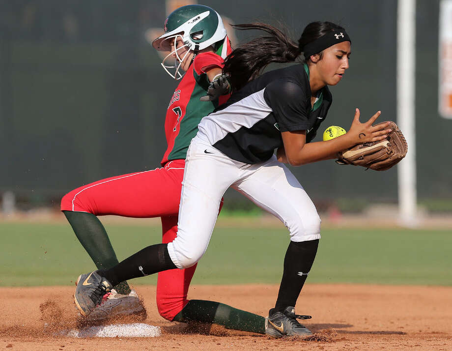 Yanira Fernandez, right, of Southwest HS grabs for the ball as Kaitlyn Stavinoha of The Woodlands reaches second base safely during their state semifinal game in Austin on Friday. Photo: Photos By Marvin Pfeiffer / Southside Reporter / Express-News 2014