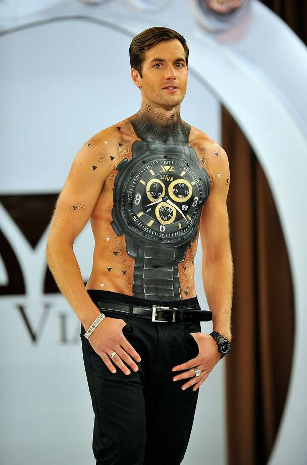 Hey, buddy, got the time? A model on the runway at Le Vian Red Carpet Revue at Mandalay Bay in Las Vegas has hands on his chest and thumbs in his pockets. Photo: David Becker, Getty Images For Le Vian