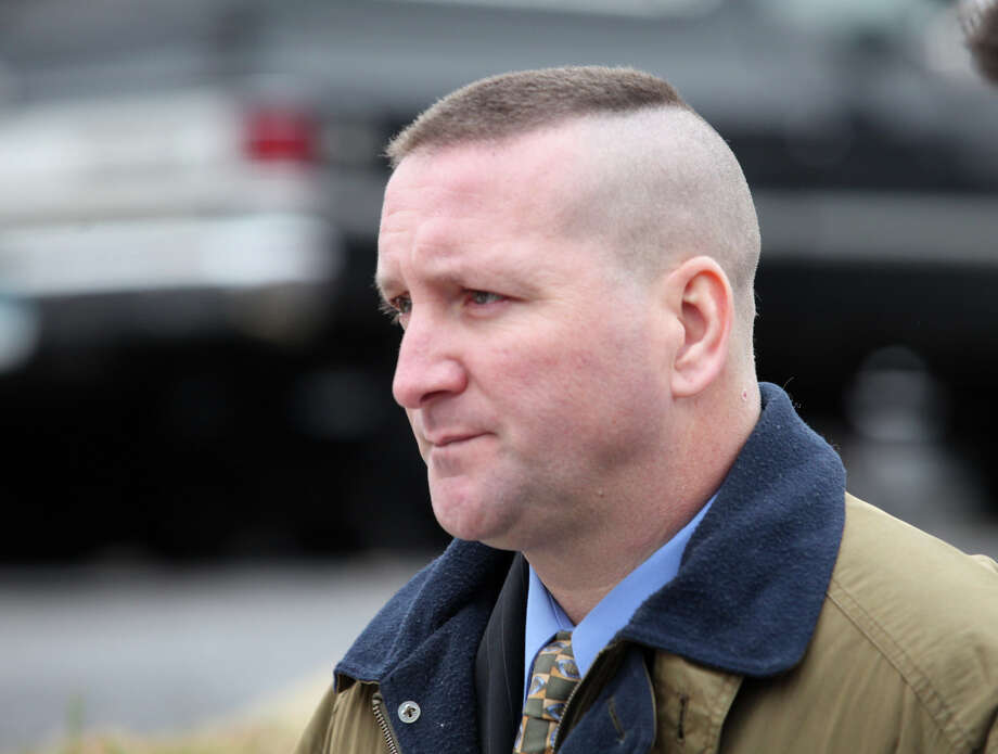 Connecticut State Police Trooper  Aaron Huntsman walks out of Bridgeport Superior Court after his arraignment on Monday, December 17, 2012. Photo: Unknown, B.K. Angeletti / Connecticut Post freelance B.K. Angeletti