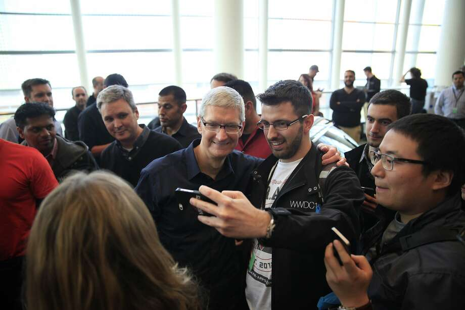 Cook  (center left) posed for photos with WWDC attendees. Photo: Lea Suzuki, The Chronicle