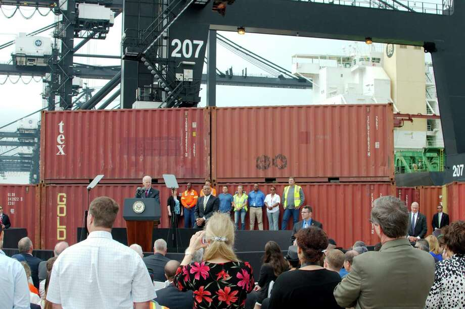 Vice President Joseph Biden speaks regarding the potential impact of the Port of Houston on the local economy during a ceremony at the Port of Houston Bayport Container Terminal on Nov. 18, 2013 in Pasadena. The Trade Promotion Authority, which gives U.S. presidents enhanced, but not unchecked, powers to promote trade, is up for renewal in Congress. (AP Photo/The Courier, Kirk Sides) Photo: Kirk Sides, MBR / Conroe Courier