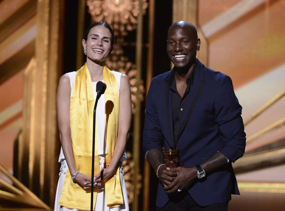 "Jordana Brewster, left, and Tyrese Gibson accept the award for best global movie for ""Fast & Furious 6"" on stage at the Huading Film Awards at the Ricardo Montalban Theater on Sunday, June 1, 2014, in Hollywood, Calif. Photo: Dan Steinberg, Associated Press"