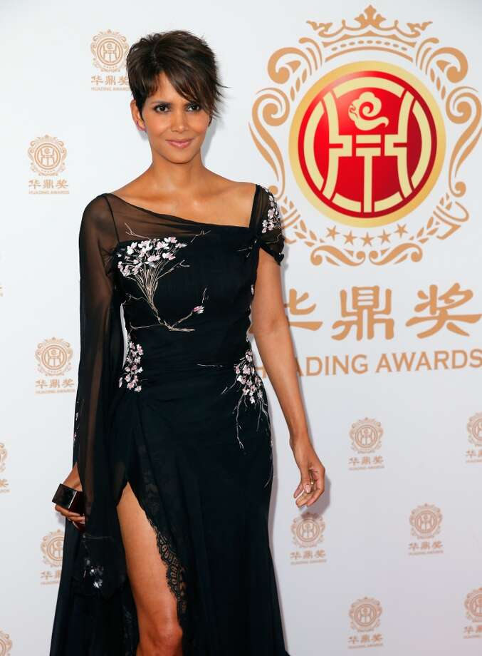 Actress Halle Berry poses with the Global Icon Award in the press room during the Huading Film Awards on June 1, 2014 at Ricardo Montalban Theatre in Los Angeles, California. Huading Film Awards is China's #1 Film awards, in the U.S. for the first time. Photo: Joe Scarnici, (Credit Too Long, See Caption)