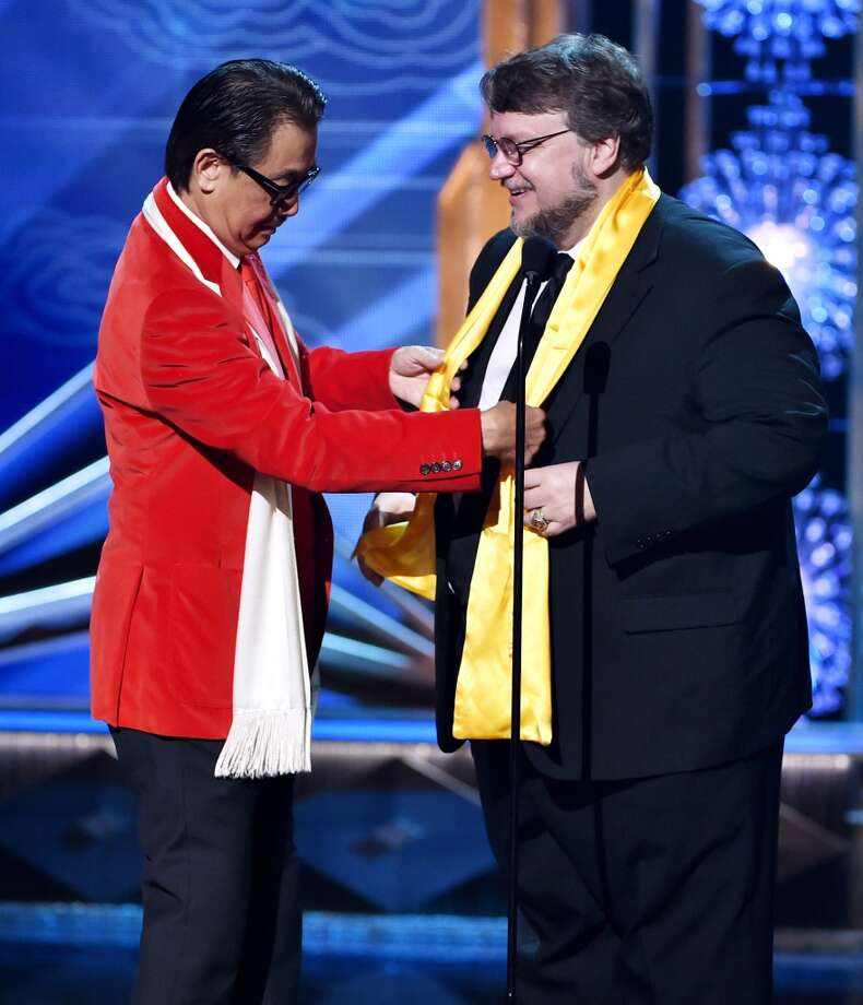 Actor George Cheung (L) presents director Guillermo del Toro the Best Global Director Award at the 2014 Huading Film Awards at The Montalban Theatre on June 1, 2014 in Los Angeles, California. Photo: Kevin Winter, Getty Images