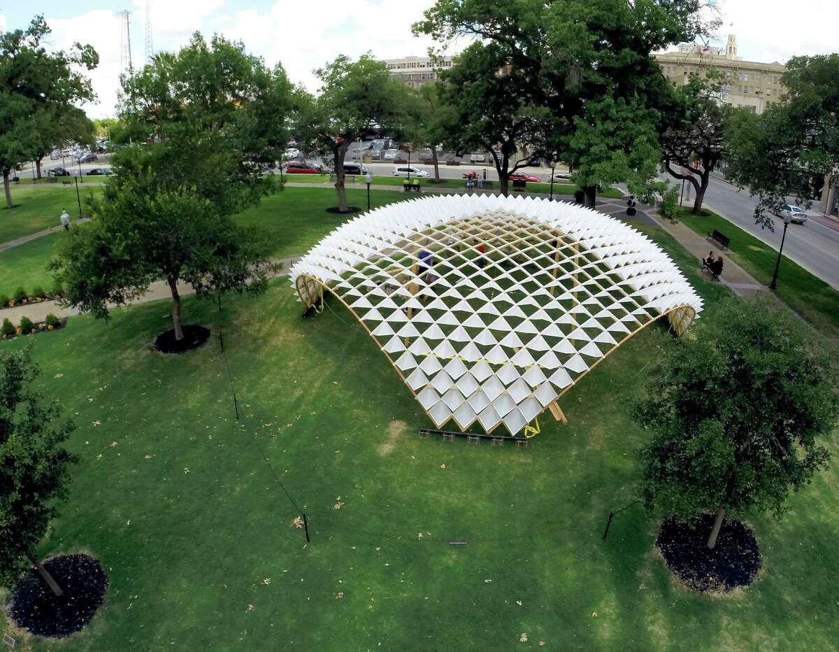 A dome sculpture designed and built by 27 graduate students at the UTSA College of Architecture and seen in a June 2, 2014 erial images taken by a quadcopter is the latest feature to be added to Travis Park since it reopened in March. The public art piece will be on display for three months before being moved to the UTSA campus or another park.