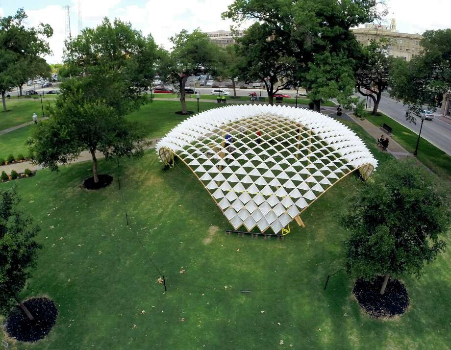 A dome sculpture designed and built by 27 graduate students at the UTSA College of Architecture and seen in a June 2, 2014 erial images taken by a quadcopter is the latest feature to be added to Travis Park since it reopened in March. The public art piece will be on display for three months before being moved to the UTSA campus or another park. Photo: William Luther, San Antonio Express-News / © 2014 San Antonio Express-News