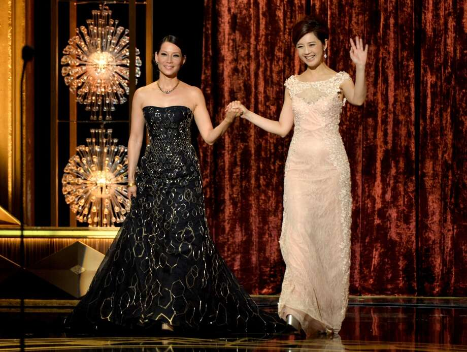 Actresses Lucy Liu (L) and Olivia Xu appear onstage at the 2014 Huading Film Awards at The Montalban Theatre on June 1, 2014 in Los Angeles, California. Photo: Kevin Winter, Getty Images