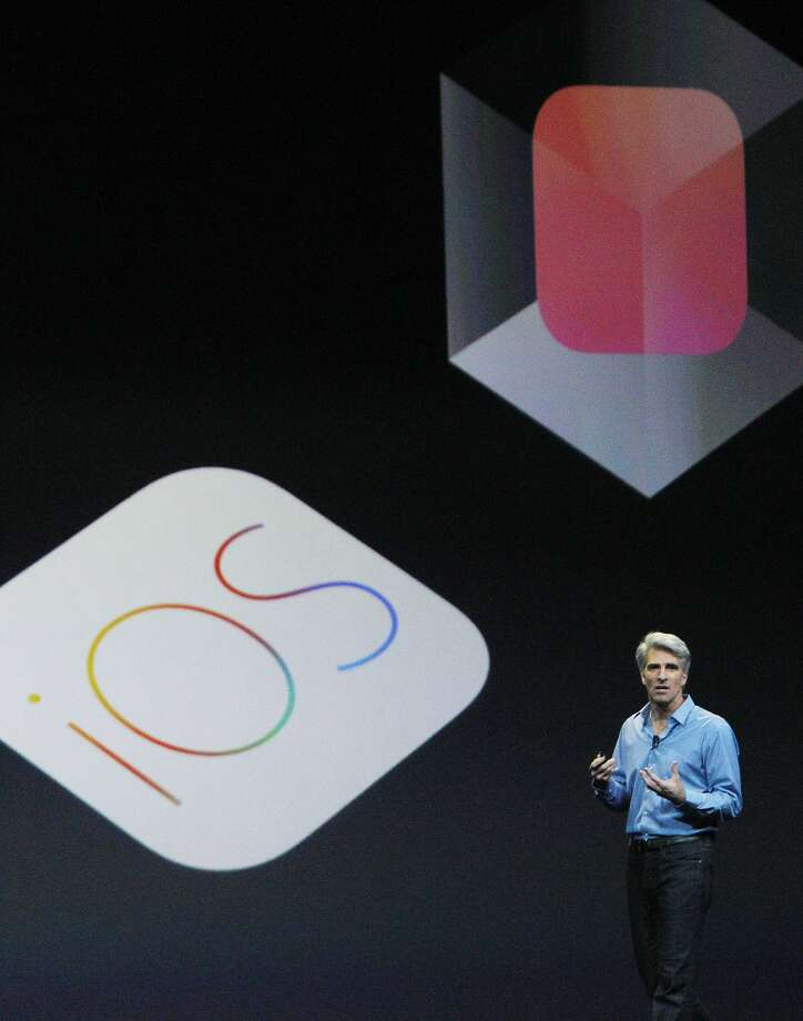 Federighi spoke during the keynote. An upcoming iOS 8 system will include an updated Messages app with features already popular in third-party apps like WhatsApp. Photo: Lea Suzuki, The Chronicle