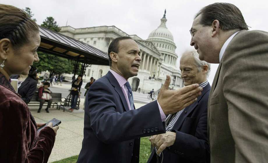 Rep. Luis Gutierrez, D-Ill. (center), speaks with immigration reform activist Frank Sharry (right) before a news conference.  Momentum on immigration reform has slowed to a crawl. Photo: J. Scott Applewhite / Associated Press / AP