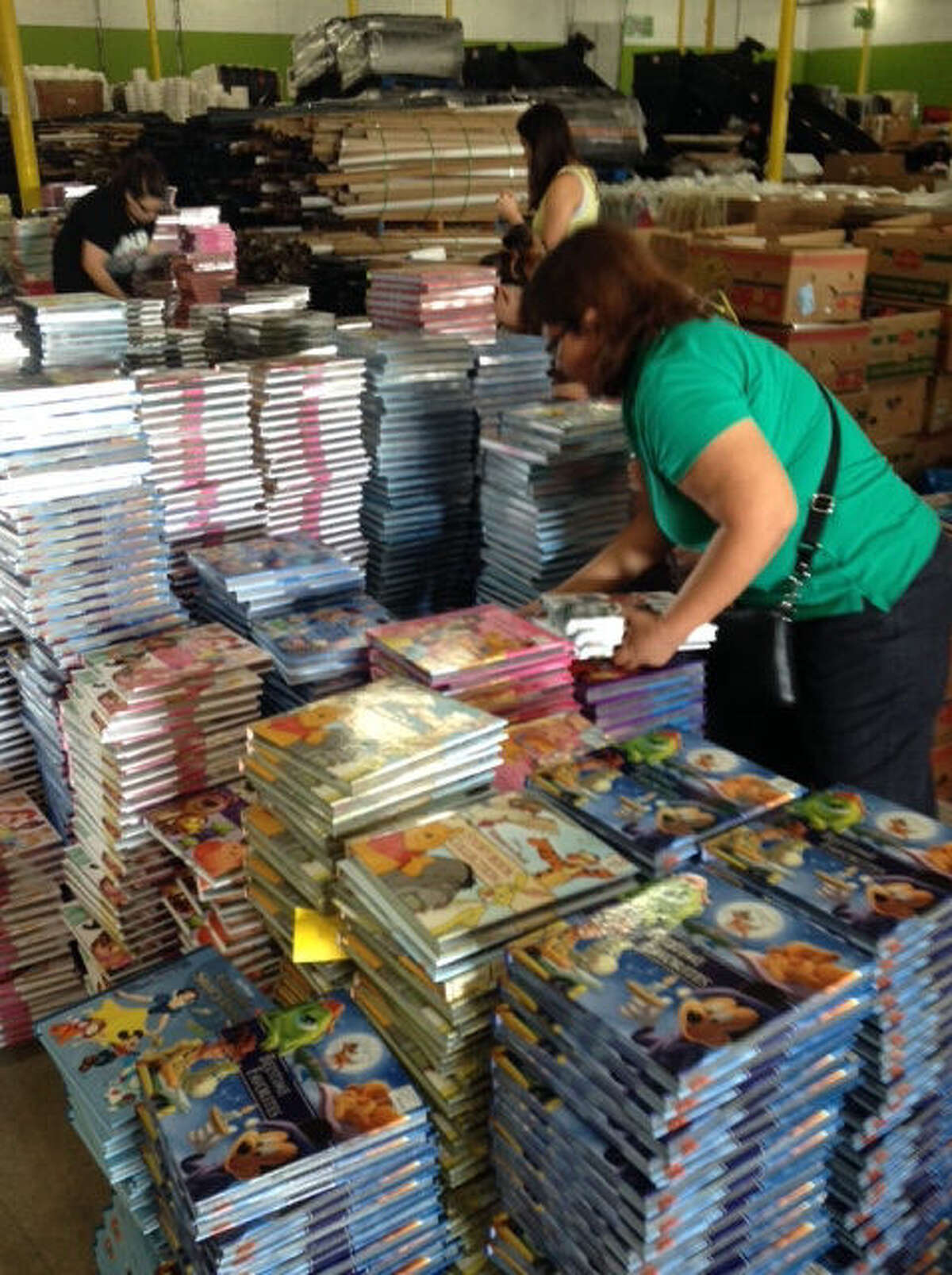 Volunteers sort some of the more than 40,000 Disney Press books that First Book-San Antonio brought to town for distribution to children from low-income homes.