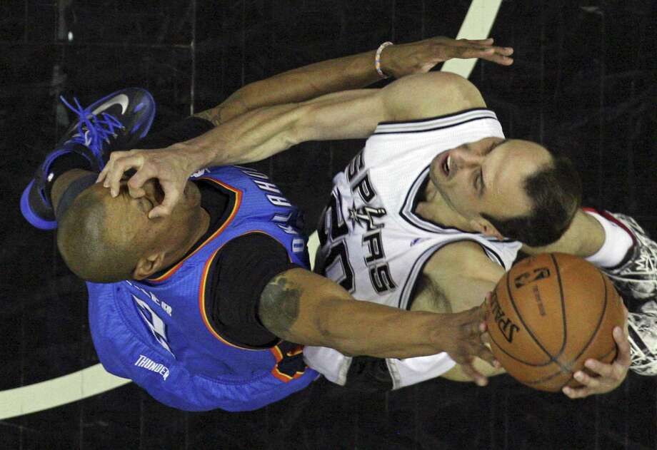 """A reader says this photo of Spurs guard/forward Manu Ginobili  and Thunder center Caron Butler proves the meaning of the word """"sport"""" has been perverted. Photo: Edward A. Ornelas / San Antonio Express-News / © 2014 San Antonio Express-News"""