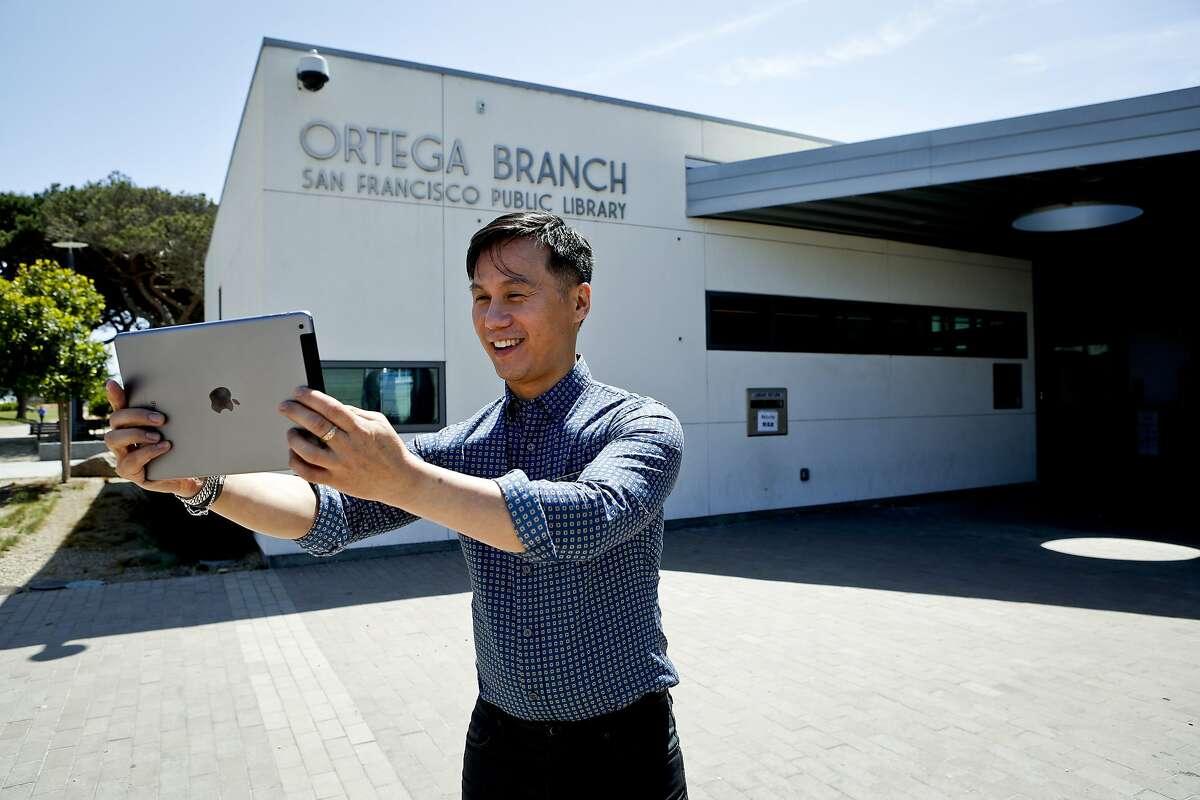BD Wong takes a selfie in front of the San Francisco Public Library Ortega Branch on Wednesday, May 7, 2014 in San Francisco, Calif.