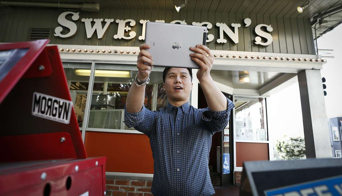 BD Wong takes a selfie in front of Swensen's Ice Cream on Russian Hill in San Francisco, Calif., on Wednesday, May 7, 2014. Wong has fond memories of his family visiting the establishment as a child.