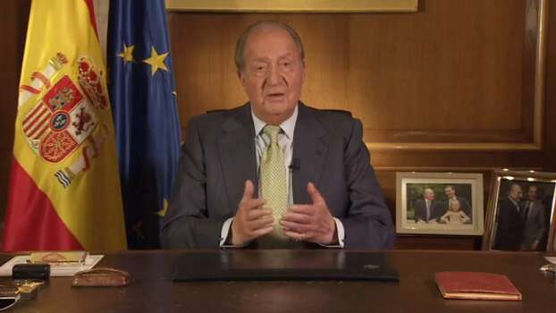 A video grab made on June 2, 2014 shows Spain's King Juan Carlos addressing the nation following his abdication, at the Zarzuela Palace in Madrid. Spanish King Juan Carlos announced his abdication on June 2, 2014 in favour of his son Prince Felipe, ending a 39-year reign that guided Spain from dictatorship to democracy but was later battered by royal scandals.  AFP PHOTO/ CASA REAL-/AFP/Getty Images Photo: -, AFP/Getty Images / AFP