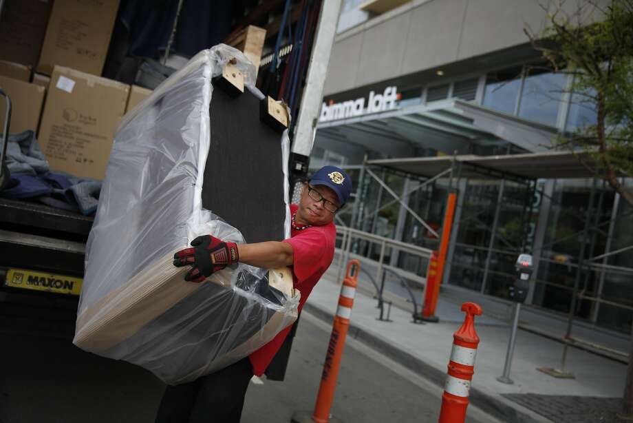 Karl Wong of Apex Fleet Service carries a delivery into Bimma Loft, which opened the day before the Mission Bay fire. Photo: Lea Suzuki, The Chronicle