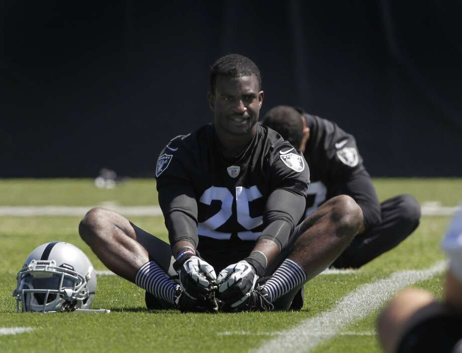 Cornerback DJ Hayden stretches before an off-season workout at the Oakland Raiders training facility in Alameda, Calif. on Tuesday, May 27, 2014. Photo: Paul Chinn, The Chronicle