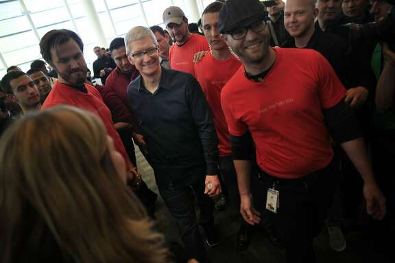 Apple chief executive officer Tim Cook  walks through Moscone West after  speaking during the keynote for the Apple Worldwide Developers Conference 2014 at Moscone West in San Francisco, Calif.
