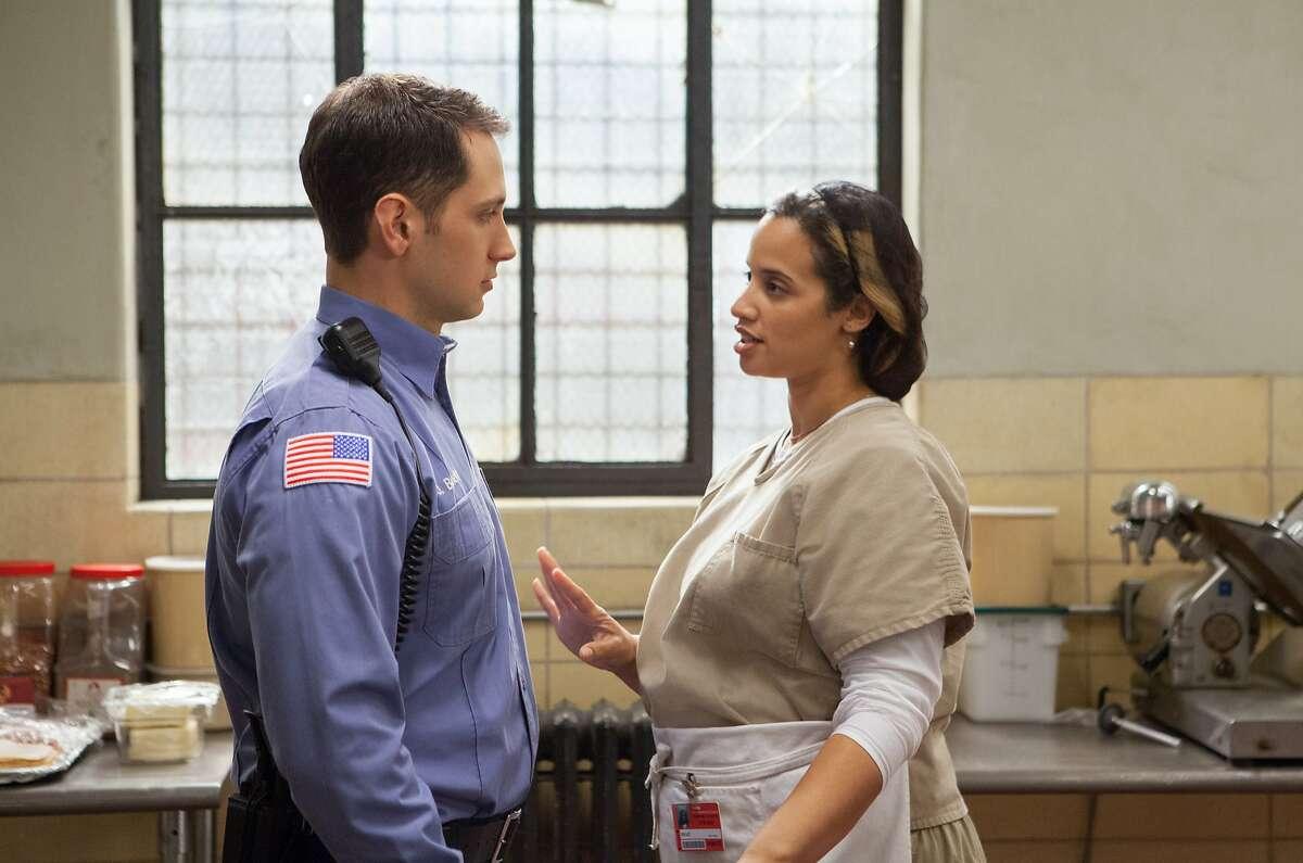 "Matt McGorry (L) and Dascha Polanco (R) in a scene from Netflix?•s ?'Orange is the New Black?"" Season 2."
