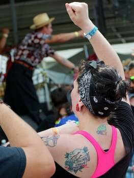 A fan cheers on Los Skarnales at Free Press Summer Festival 2014 Photo: Jay Dryden/For The Houston Chronicle / copyright 2014 Jay Dryden