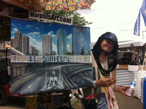 Local artist Chris Morphis stands next to his work at Free Press Summer Fest 2014 Photo: Andrea Waguespack