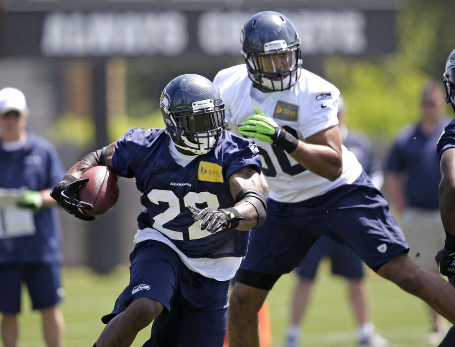 Seattle Seahawks running back Robert Turbin carries the ball at Seahawks OTAs on Monday. Photo: Elaine Thompson, Associated Press