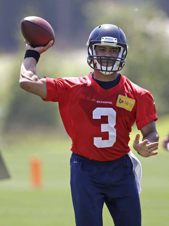 Seattle Seahawks quarterback Russell Wilson passes at Seahawks OTAs on Monday. Photo: Elaine Thompson, Associated Press
