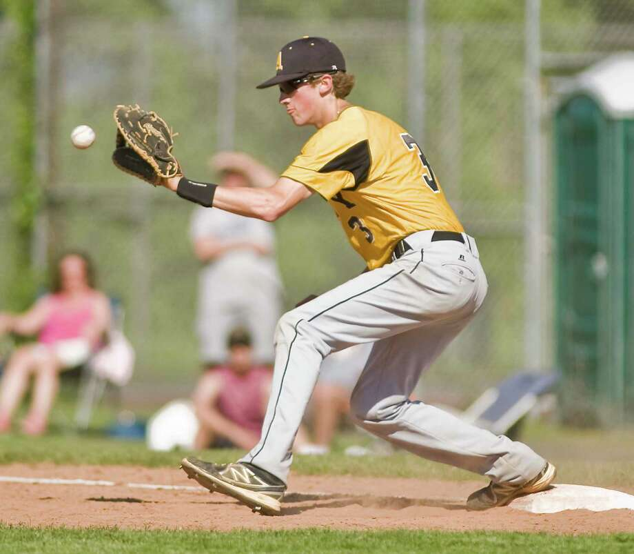 Amity High School's Christopher Winkel takes a throw at first base during the first round of the Class LL state tournament game against Danbury High School, played at Danbury. Monday, June 2, 2014 Photo: Scott Mullin / The News-Times Freelance