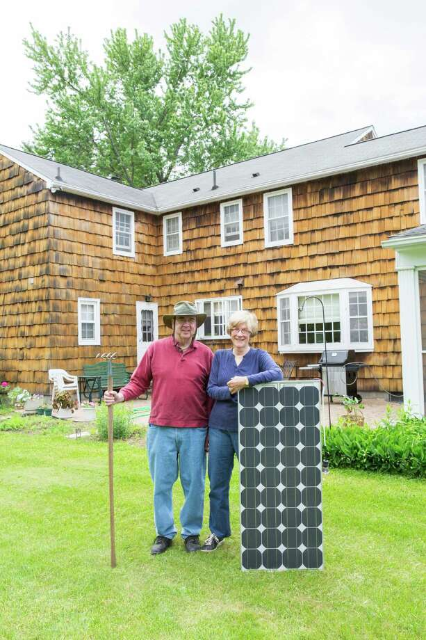 Troy residents Sharon and Harry Roy are looking to add a solar power system to their home under Solarize Troy, a new purchasing cooperative that aims to make such systems cheaper to install. Courtesy of Solarize Troy) Photo: Kyle Plante / Kyle Plante