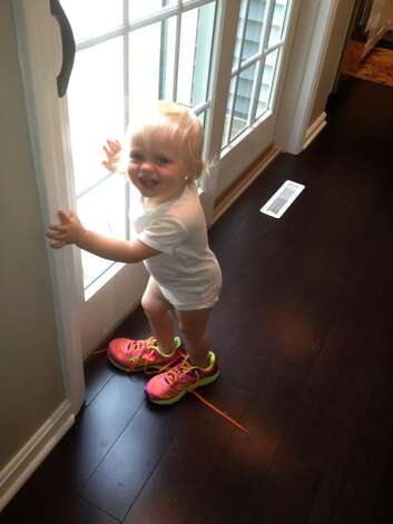 """21-month old Ryhan Irelynn Hotaling, daughter of Lori and Chad Hotaling of Delmar, hopes to follow in the footsteps of mom, who was preparing for the Freihofer's Run for Women held on Saturday. Ryhan is the granddaughter of Dr. John and Linda Metallo of Slingerlands. Grand-dad says, """"Look out record books!"""" (John Metallo)"""
