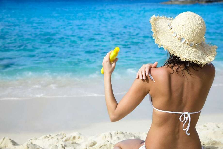 When choosing a sunscreen, the National Council on Skin Cancer Prevention recommends a Broad Spectrum sunscreen with a sun protection factor of 30 or higher for protection from ultraviolet A and ultraviolet B  rays, which contribute to premature aging, sunburn and skin cancer. Photo: Christian Wheatley, Fotolia