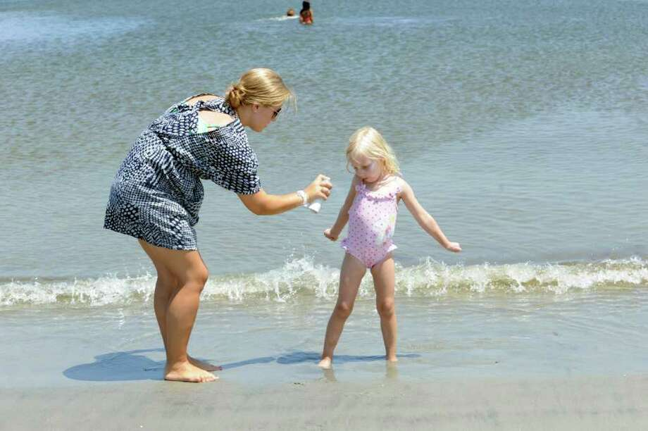 Sunscreen should always be applied liberally, and reapplied after swimming or excessive sweating. Photo: Helen Neafsey / Greenwich Time