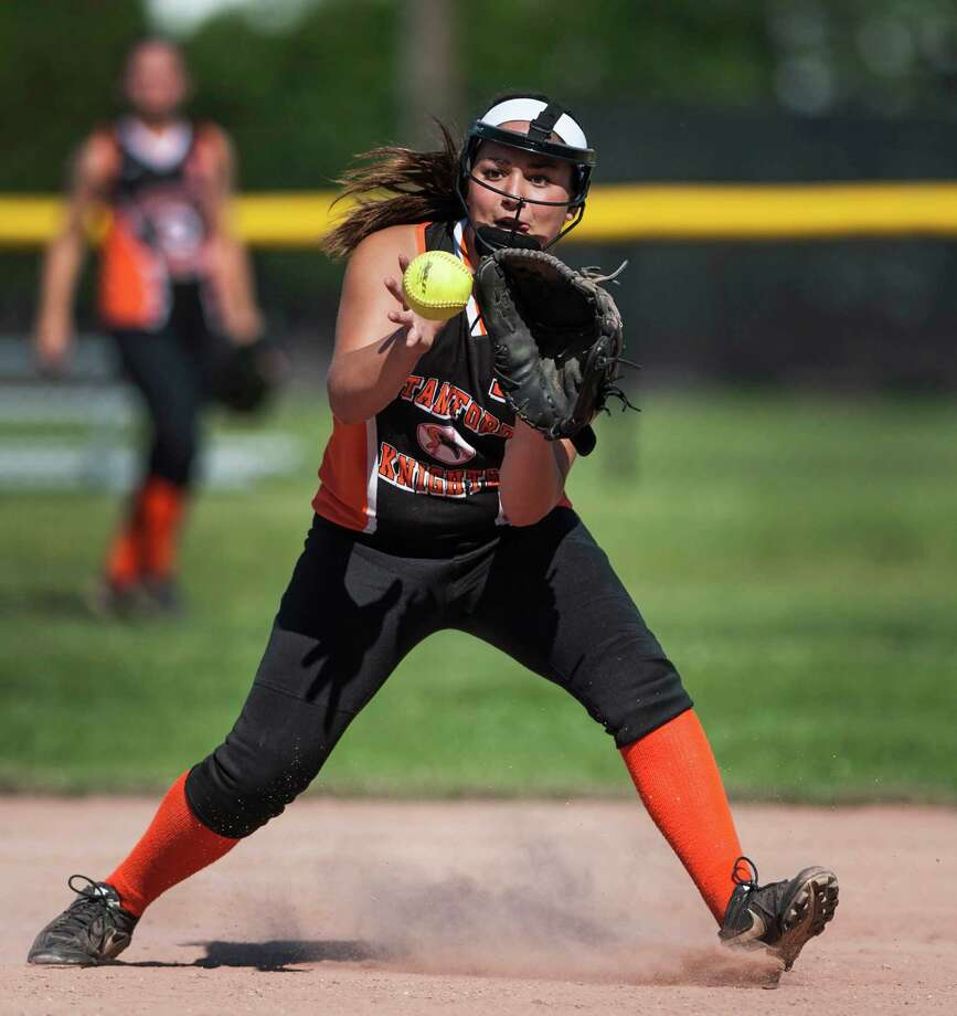 Stamford high school shortstop Maddie Santora fields a ground ball in a first round game of the CIAC class LL softball tournament against New Canaan high school played at Stamford high school, Stamford, CT on Monday June 1st, 2014. Photo: Mark Conrad / Connecticut Post Freelance