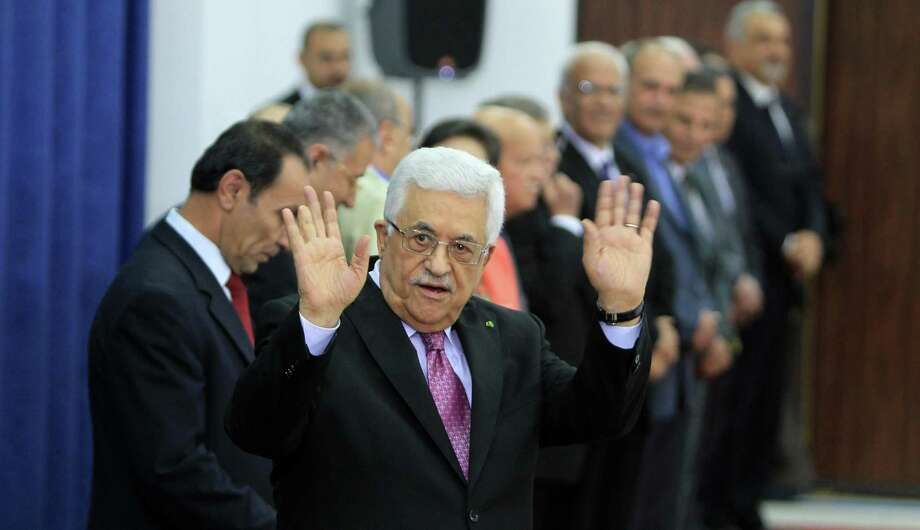Palestinian Authority President Mahmoud Abbas swore in a new government and said it will follow his political program backing a negotiated, two-state solution to the Israeli-Palestinian conflict. Photo: Abbas Momani / Getty Images / AFP
