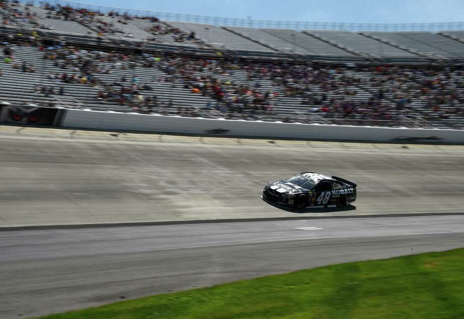 Jimmie Johnson drives during the NASCAR Sprint Cup series auto race, Sunday, June 1, 2014, at Dover International Speedway in Dover, Del. (AP Photo/Molly Riley)  ORG XMIT: DOV219 Photo: Molly Riley / FR170882 AP