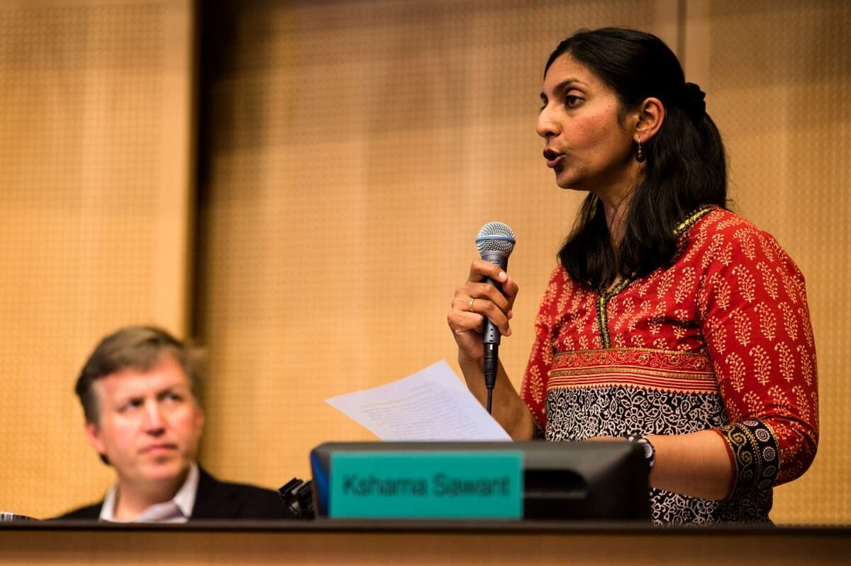 Socialist Seattle City Council member Kshama Sawant, right, tries to roll back provisions - such as training wages and a temporary incorporation of tips into the 15 dollar wage - Monday, June 2, 2014, at City Hall in Seattle. Phased in over the next seven years, Seattle will have the highest minimum wage in America. (Jordan Stead, seattlepi.com)