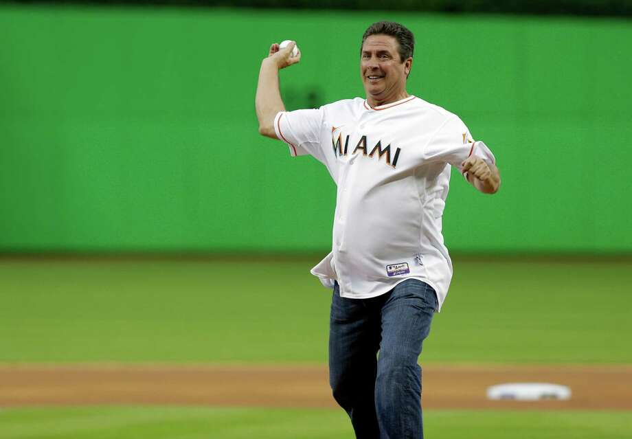 fprmer Miami dolphins quarterback Dan Marino throws out the ceremonial first pitch before an opening day baseball game between the Miami Marlins and Colorado Rockies, Monday, March 31, 2014, in Miami. (AP Photo/Lynne Sladky) Photo: Lynne Sladky, Associated Press / AP