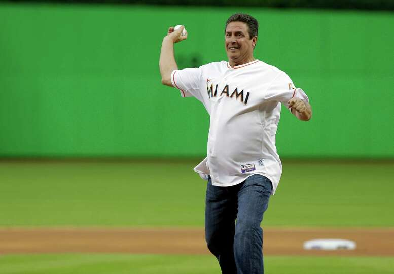 fprmer Miami dolphins quarterback Dan Marino throws out the ceremonial first pitch before an opening