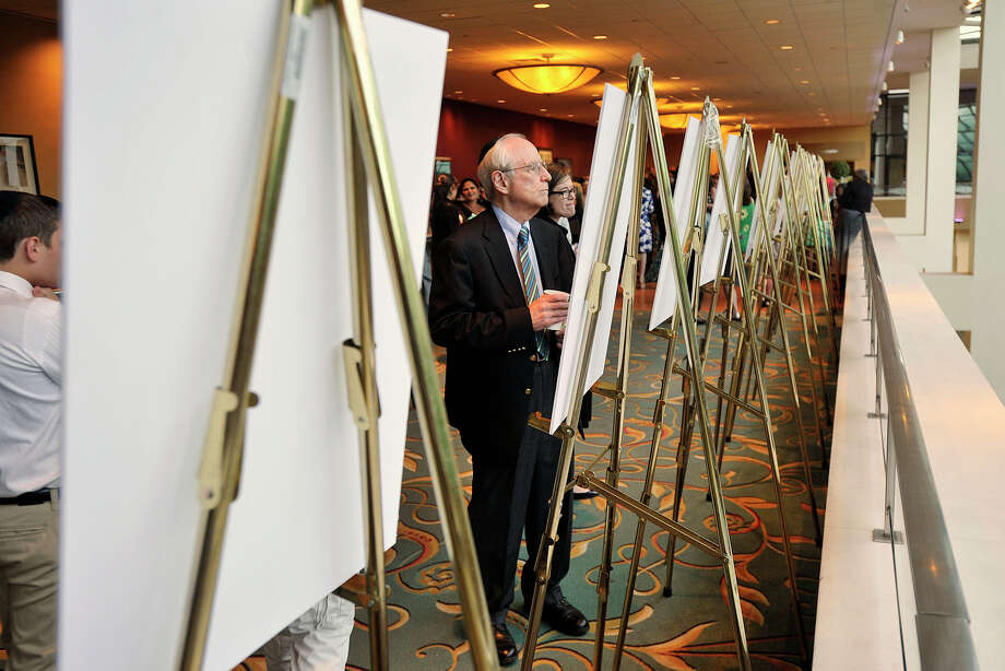 Ed Schechter looks at the display boards showing the different aspects of what the Friendship Circle does during the Friendship Circle's Evening of Appreciation - Mitzvah Celebration at Stamford Hilton in Stamford, Conn., on Sunday, June 1, 2014. Friendship Circle is a local organization that pairs teenage volunteers with children with special needs. The event honored 300 teens that volunteered through the organization. Photo: Jason Rearick / Stamford Advocate