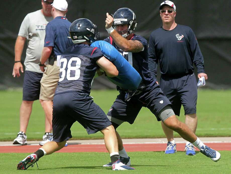 Tight ends Garrett Graham, left, the Texans' veteran at the position going into his fifth NFL season, and rookie C.J. Fiedorowicz, a third-round draft pick, mix it up at Monday's workout. Photo: J. Patric Schneider, Freelance / © 2014 Houston Chronicle