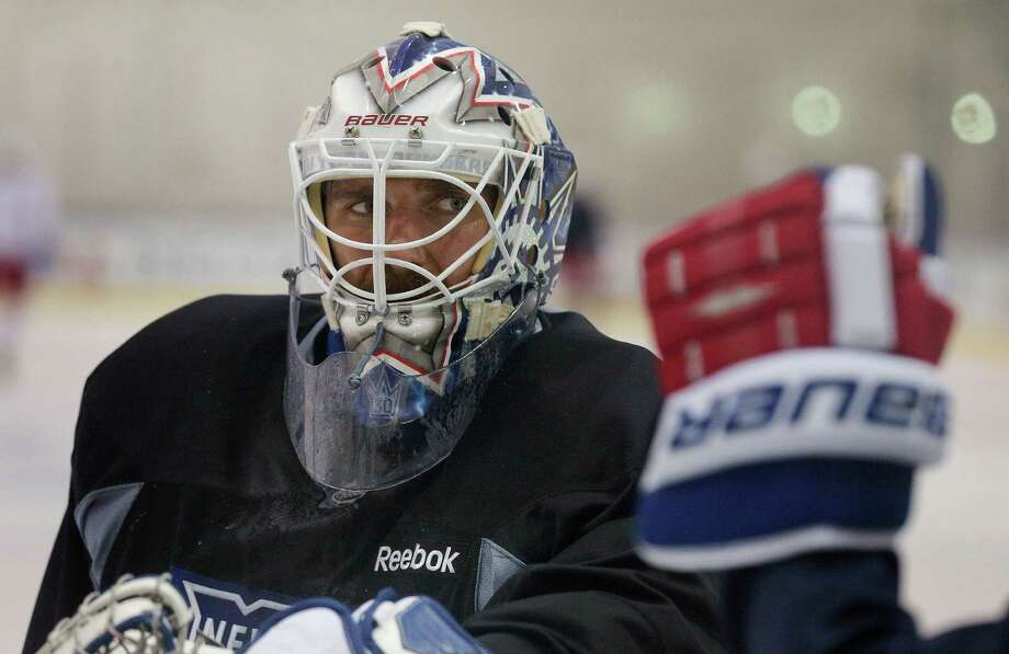 New York Rangers goalie Henrik Lundqvist listens for instructions during a drill at practice, Monday, June 2, 2014, in Greenburgh, N.Y. The Rangers will face the Los Angeles Kings in Game 1 of Stanley Cup Final in Los Angeles on Wednesday. (AP Photo/Julie Jacobson) ORG XMIT: NYJJ111 Photo: Julie Jacobson / AP