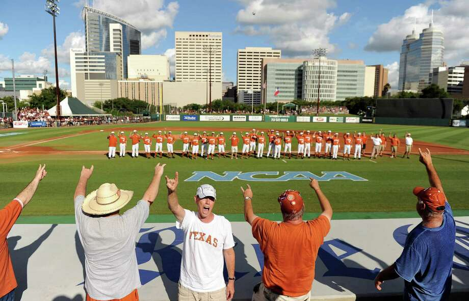 "Fans of the Texas Longhorns sing ""The Eyes of Texas"" with the team before an NCAA baseball regional game against Texas A&M, Monday, June 2, 2014, at Reckling Park in Houston. Photo: Eric Christian Smith, For The Chronicle"