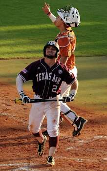 Texas A&M's Ryne Birk reacts after striking out during the fifth inning of an NCAA baseball regional game against Texas, Monday, June 2, 2014, at Reckling Park in Houston. Photo: Eric Christian Smith, For The Chronicle