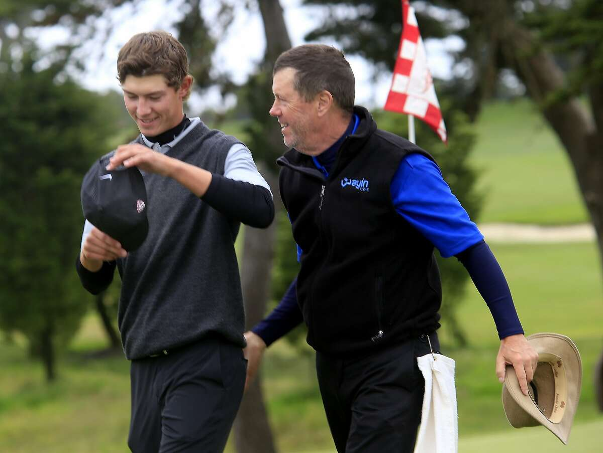 Maverick McNealy (left) and his father Scott, who worked as his caddy, smiled as they walked away from the 18th hole at the Olympic Club. Qualifying rounds for the U.S. Open were held at The Olympic Club and Lake Merced.