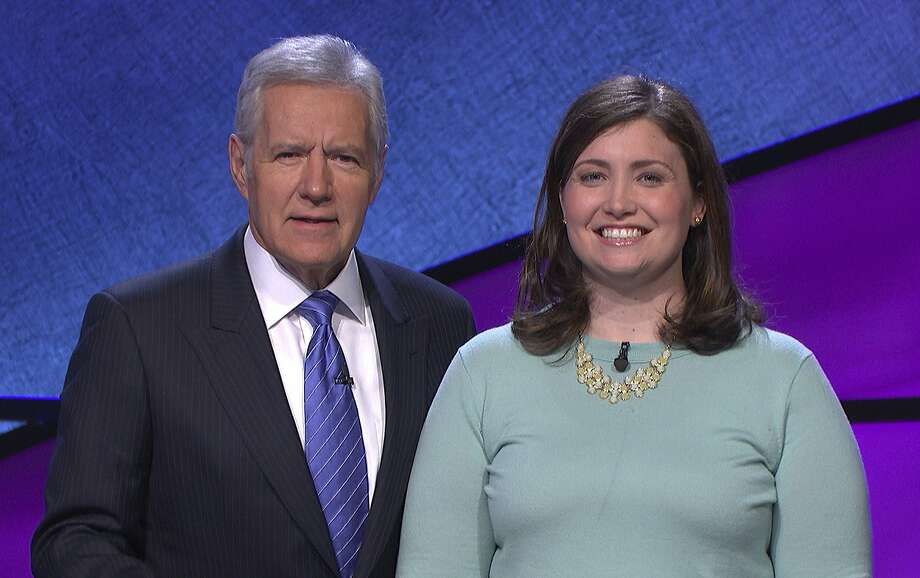 Host Alex Trebek poses with Julia Collins. The Kenilworth, Ill., woman won 20 consecutive 'Jeopardy!' matches. Photo: Associated Press