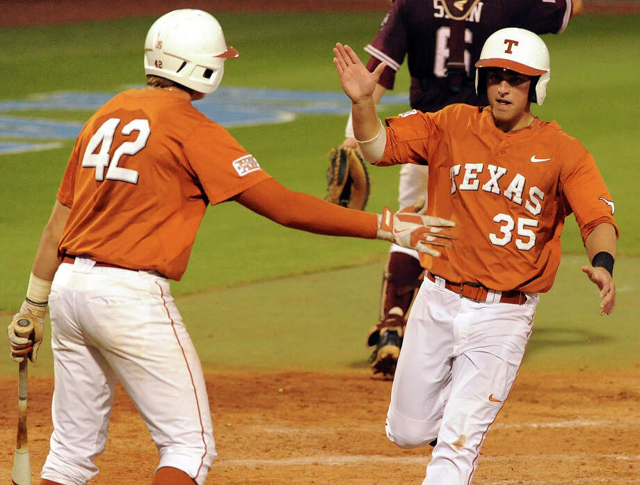 Texas' Madison Carter, right, celebrates his run scored with Kacy Clemens during the seventh inning of an NCAA baseball regional game against Texas A&M, Monday, June 2, 2014, at Reckling Park in Houston. Photo: Eric Christian Smith, For The Chronicle