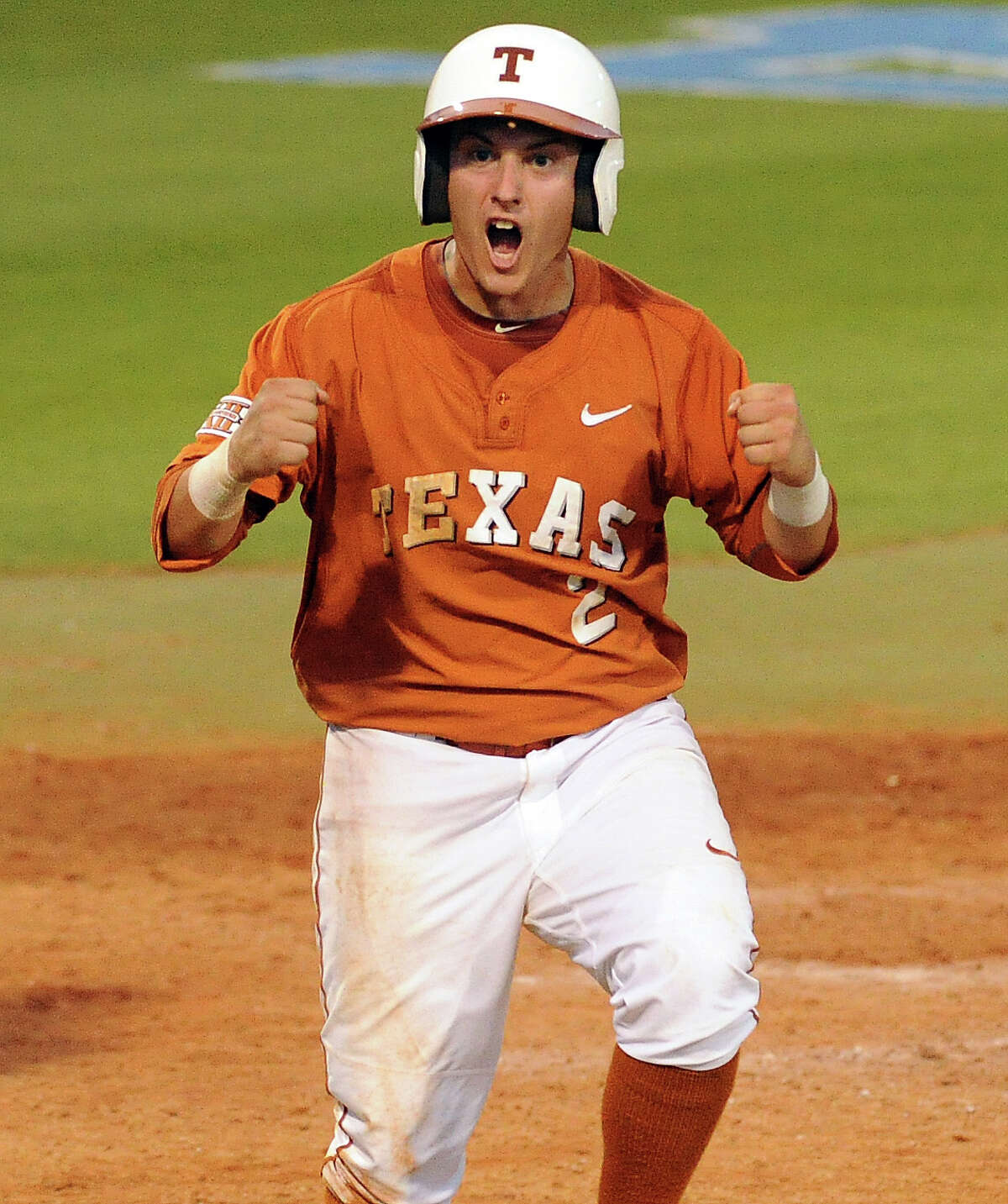 Texas' Mark Payton reacts after scoring a run during the seventh inning of an NCAA baseball regional game against Texas A&M, Monday, June 2, 2014, at Reckling Park in Houston.