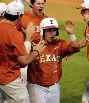 Texas' Mark Payton (2) celebrates his run scored during the seventh inning of an NCAA baseball regional game against Texas A&M, Monday, June 2, 2014, at Reckling Park in Houston. Photo: Eric Christian Smith, For The Chronicle